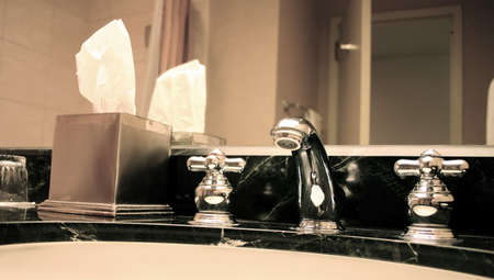 Bathroom Still Life: Elegant Chrome Faucet and Sink photo