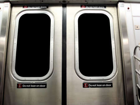 New York City Subway Train with Do Not Lean on Door Warning Sign Stock Photo