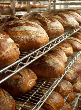 Shelves of Fresh Baked Artisinal Bread in Bakery Stock Photo