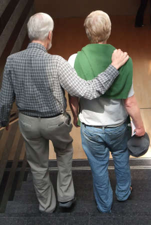 behind: Senior Father with Adult Son From Behind
