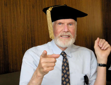 distinguished: Distinguished Senior Professor in Graduation Cap and Tassel