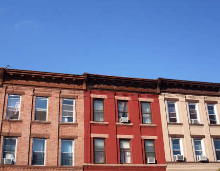 Colorful row of apartment buildings on block in Brooklyn