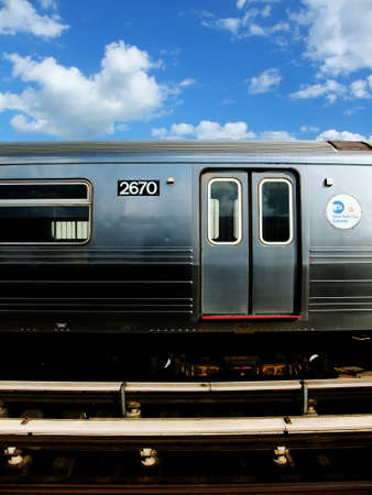 New York City Subway Train Riding on Elevated Track Stock Photo