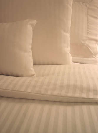 bed sheet: Detail of bed with set of crisp striped sheets and pillows Stock Photo