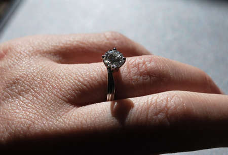 Detail View of Diamond Engagement Ring on Hand of Woman Stock Photo - 3733410