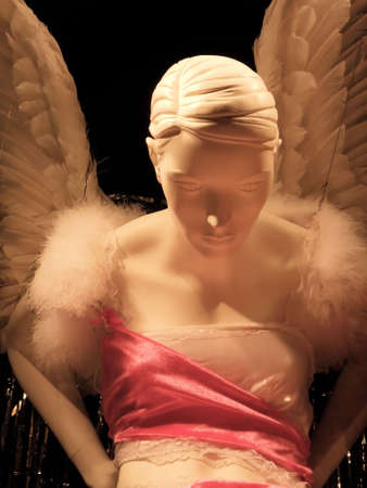 Surreal alabaster mannequin dressed in angel wings