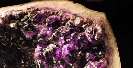 gemology: Closeup detail of amethyst crystals in geode