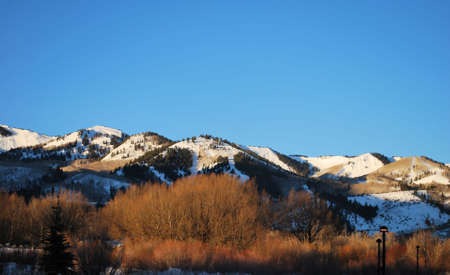 salt lake city: Snowy Ski Slopes on Mountains in Park City, Utah, in the Early Morning Light