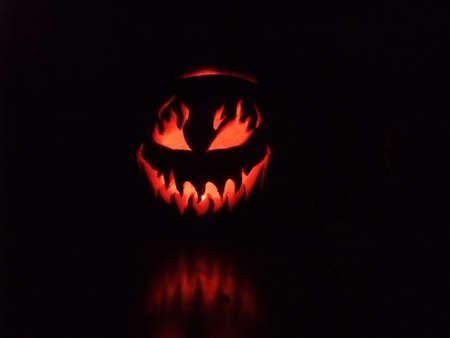 Spooky Halloween Pumpkin Illuminated at Night