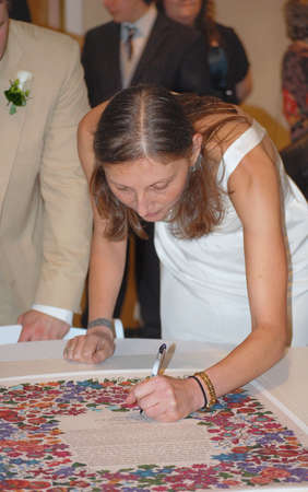 Bride Signing Traditional Ketubah During Jewish Wedding Ceremony 스톡 콘텐츠