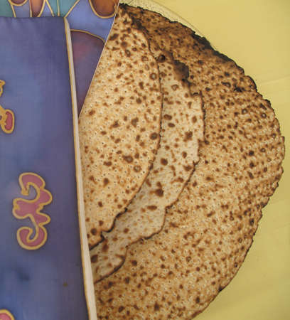 jewish cuisine: Jewish Holidays  Traditional Matzah Laid Out on Passover Seder Table