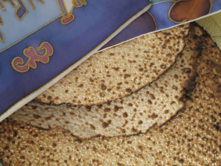 matzah: Jewish Holidays  Traditional Matzah Laid Out on Passover Seder Table
