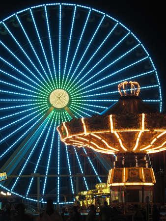 wildwood: Ferris Wheel and Carousel in Amusement Park at Night