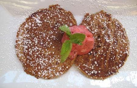 Breakfast  Hot buckwheat pancakes with fresh berry yogurt and powdered sugar topping