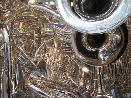 heap: Many brass horns in a tangle: tubas, trombones, trumpets, and bugle Stock Photo