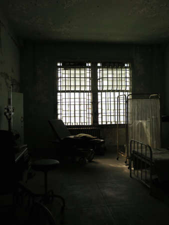 sanitarium: Gloomy and abandoned antique historical hospital room interior Stock Photo