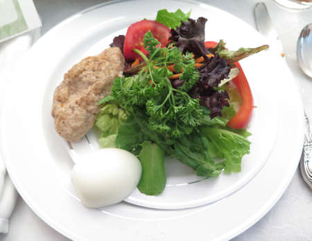jewish cuisine: Jewish Holidays Traditional Passover Gefilte Fish, Egg and Parsley on Seder Plate