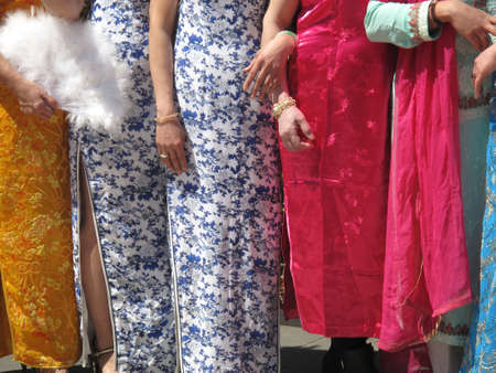 bridesmaids: Line of bridesmaids at Asian wedding in colorful dresses