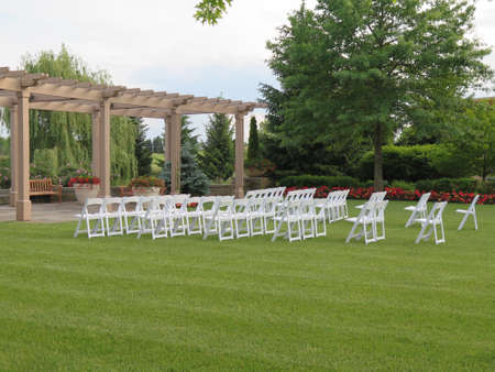 folding chair: White empty chairs set for outdoor wedding ceremony
