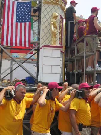 steel tower: Traditional Italian Giglio Parade 112th anniversary Catholic Parade, Williamsburg, Brooklyn, 2015: men carry one-ton steel tower