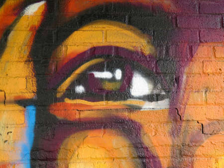 vandal: Painted Wall: Colorful Abstract Eye in Detail of Graffiti