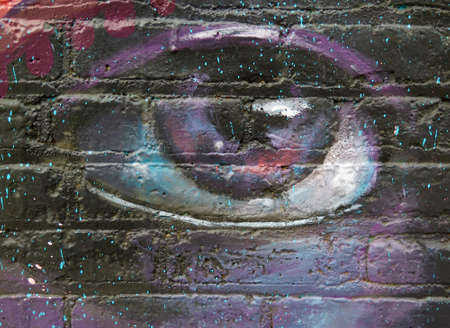 graffiti brown: Painted Wall: Colorful Abstract Eye in Detail of Graffiti