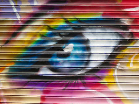 Painted Wall: Colorful Abstract Eye in Detail of Graffiti