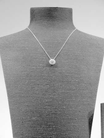 beauty shop: Elegant diamond necklace on mannequin on display in store window