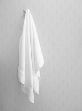 Soft white towel hanging in bathroom interior Banco de Imagens