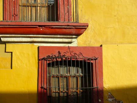 oaxaca: Detail of colorful yellow wall in Oaxaca, Mexico