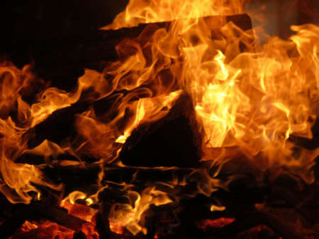 elemental: Detail of burning logs, fire, and flames in fireplace or campfire Stock Photo