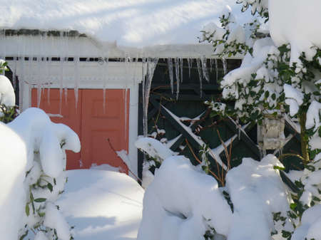 blanketed: Detail of front door of house blocked by pile of snow after snowstorm