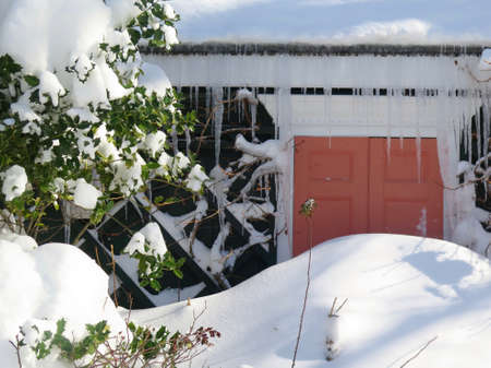 deep freeze: Detail of front door of house blocked by pile of snow after snowstorm