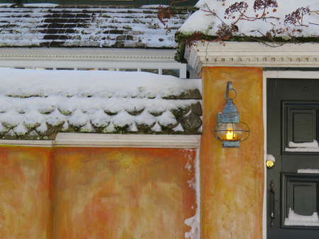blanketed: Detail of cottage with copper lantern in snow filled Winter landscape
