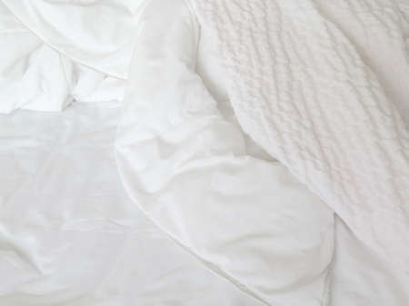 bedding: Detail of bed with set of white morning bedding Stock Photo