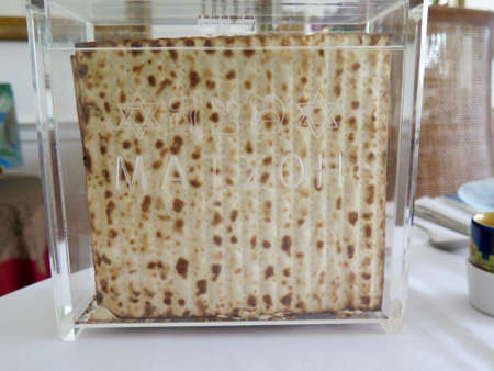matzot: Holidays  Traditional Matzot Laid Out on Passover Seder Table