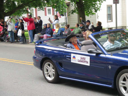 fame: Oldest living boxing Champion, 94 year old Jake LaMotta riding in the Parade of Champions, Induction Weekend, International Boxing Hall of Fame, Canastota, New York, June 12, 2016
