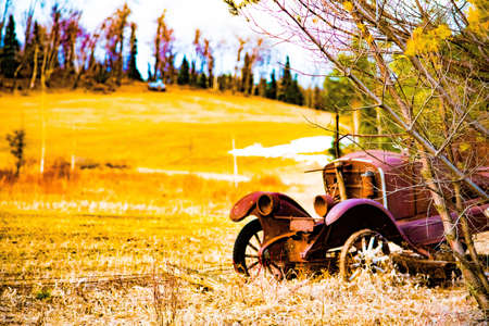 fence: Classic car by barb wire fence