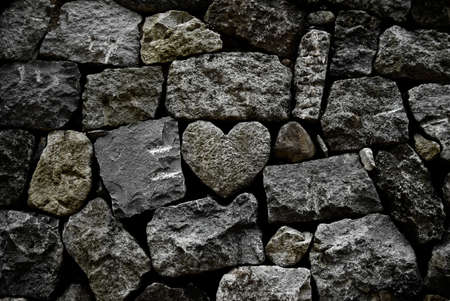 heart of stone: Romantic rock heart in artificial riverbed Stock Photo