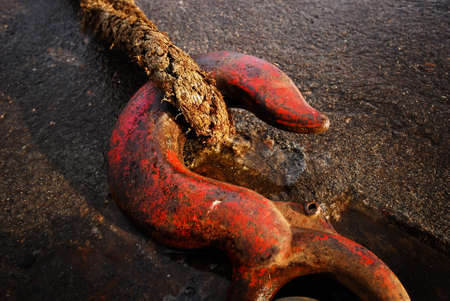 tightly: Rope tightly held to a hook on concrete Stock Photo
