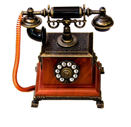 ancient telephone: Single vintage phone against white background