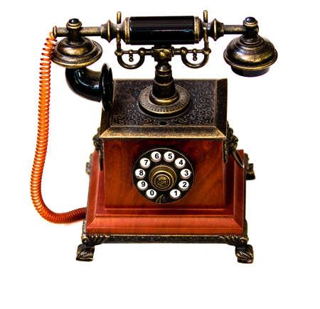 telefono antico: Telefonico unico annata contro sfondo bianco