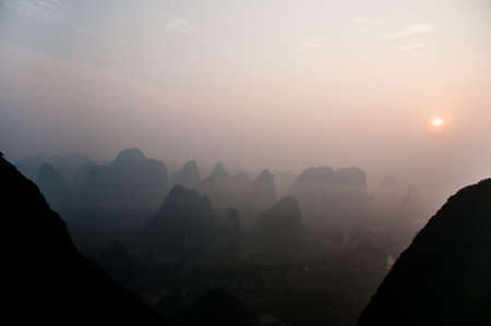 guilin: Fog covers the famous karst mountains of the Guanxi region, southern China, early in the morning.