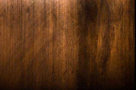 decades: Dirty copper plate shows its details while shining under soft light Stock Photo