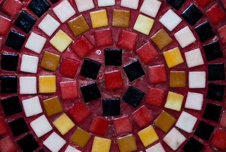 Close image of a circular ceramic mosaic arrangement, many colors photo