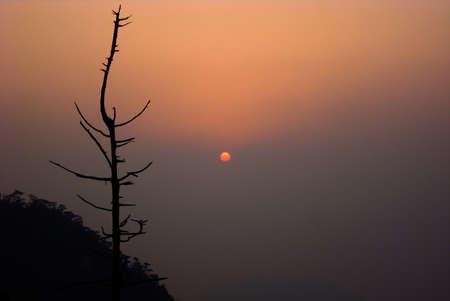 mountain peek: Sun starts peeking through heavy fog from mount Misen, Miyajima, Japan