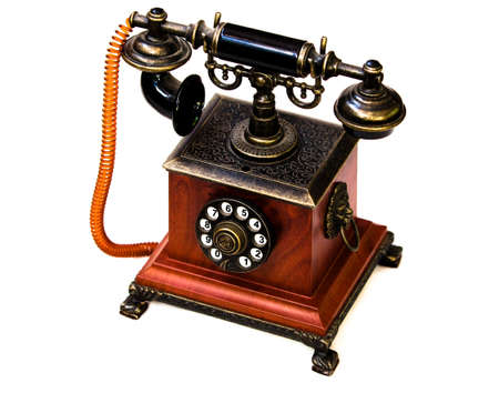 Lateral view of old brown phone isolated against white background photo