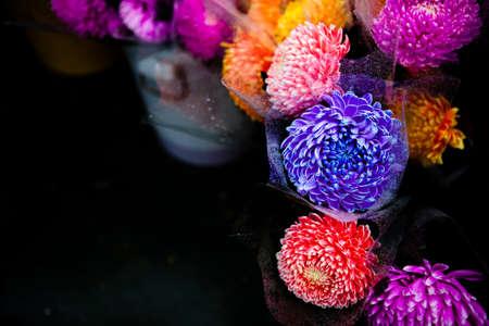 await: chrysanthemums of different colors await bidders at a flower market Stock Photo