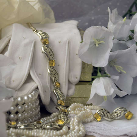 Vintage gloves, necklace with topazes, pearls, veil and white bellflowers photo