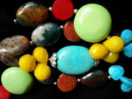 Asian beads with turquoise, jasper, serpentine, aventurine, quartz, agate, red coral and other colour gemstones photo